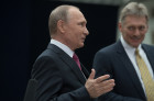 Russian President Vladimir Putin answers journalists' questions