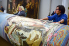 Dismantling and replacement of Frina at Poseidon's Festival painting at Russian Museum