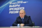 President Vladimir Putin visits his campaign headquarters in Moscow