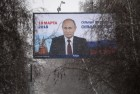 Campaign posters in support of incumbent Russian President Vladimir Putin