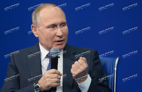 Russian presidential candidate Vladimir Putin meets with his authorized representatives