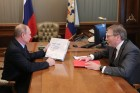 Russian President Vladimir Putin meets with Commissioner for Entrepreneurs' Rights Boris Titov