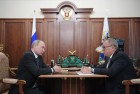 President Vladimir Putin meets with Head of VTB Bank Andrei Kostin