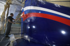 Sukhoi Superjet plane painted in Aeroflot livery