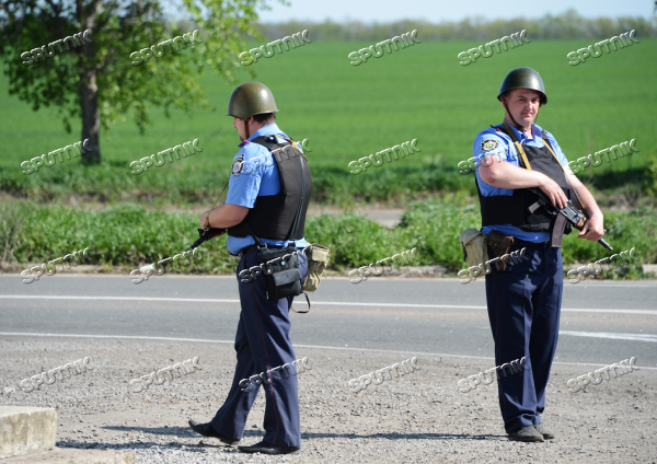 Ukrainian police officers at traffic checkpoint