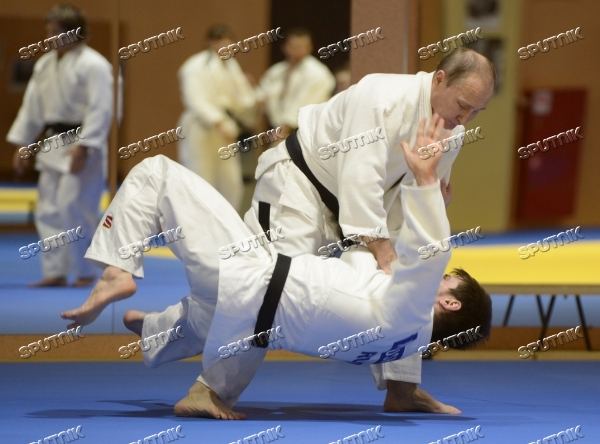 President Vladimir Putin meets with Russian judo national team members