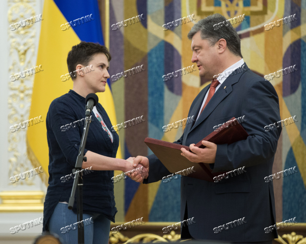 Ukrainian President Petro Poroshenko awards Nadezhda Savchenko the Order of Gold Star