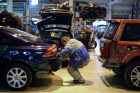 Work in car body repair service center