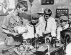 PIONEERS STUDYING RADIO DEVICE