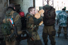 DPR self-defense fighters bring humanitarian aid to Debaltsevo
