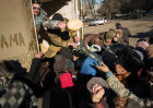 DPR self-defense fighters deliver humanitarian aid for Debaltsevo residents