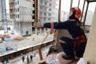Construction crane falls on multi-story residential building in Novosibirsk