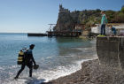 Diver examinsation and bottom cleansing off Crimean beach shore