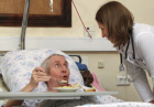 Patient speaks with doctor at Moscow's Hospice No. 1